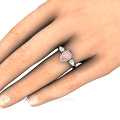 Pink Pear Moissanite Engagement Ring on Finger Rare Earth Jewelry