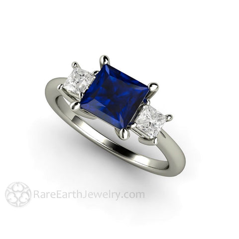 Blue Sapphire Engagement Ring 3 Stone with Princess cut Diamonds