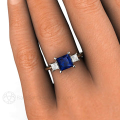 Rare Earth Jewelry 3 Stone Princess Cut Diamonds and Blue Sapphire Ring on Finger