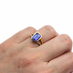 Emerald Cut Blue Sapphire Ring on Finger Rare Earth Jewelry