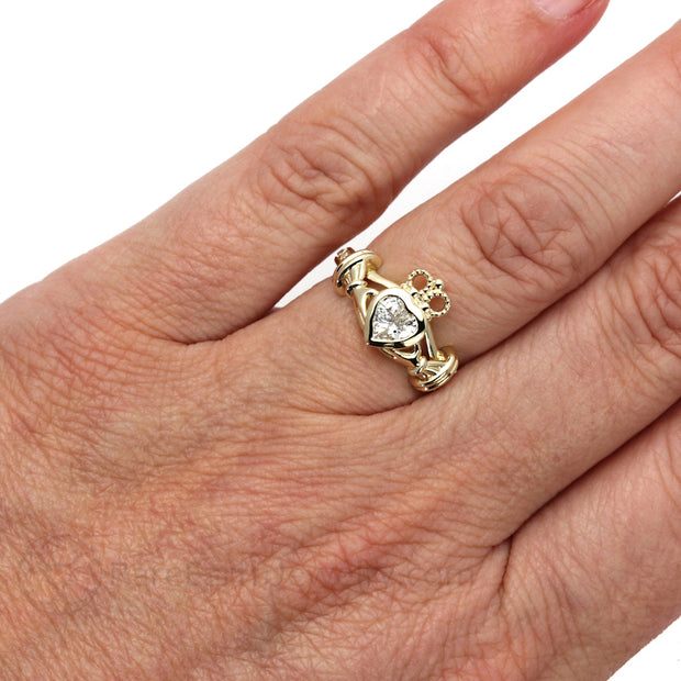 Rare Earth Jewelry 14K Yellow Gold Moissanite Claddagh Ring on Finger