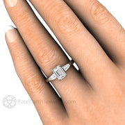 Rare Earth Jewelry Emerald and Baguette Diamond Engagement Ring on Finger