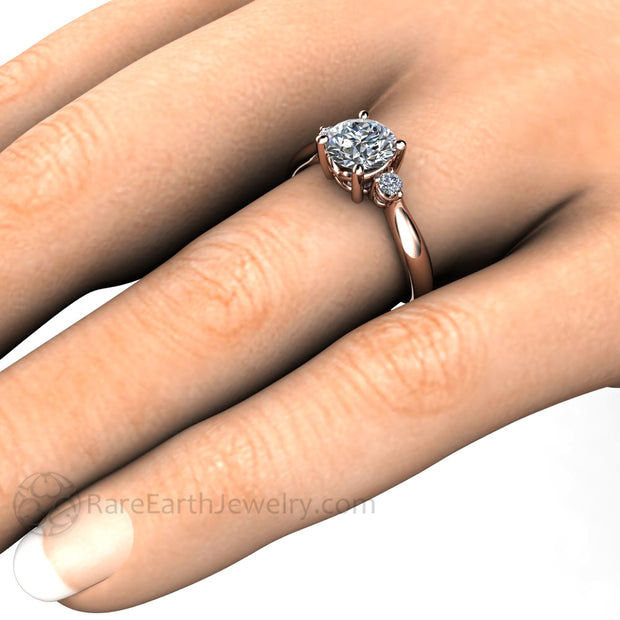 Rare Earth Jewelry Moissanite 3 Stone Engagement Ring on Finger Rose Gold with Diamond Side Stones
