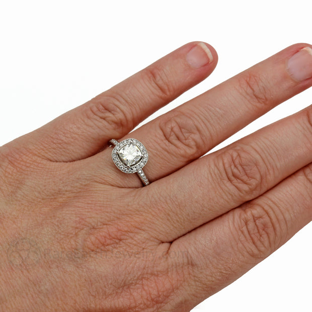 Rare Earth Jewelry Platinum Forever One Moissanite Wedding Ring on Finger Cushion Diamond Halo