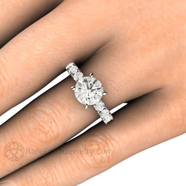 Rare Earth Jewelry Moissanite Engagement Ring on Finger 2 Carat Round Cut Center with Accented Band