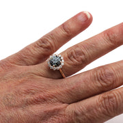 Gray Moissanite Engagement Ring with Halo on Hand in 14K Rose Gold by Rare Earth Jewelry