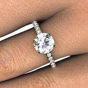 Rare Earth Jewelry Moissanite Solitaire and Diamond Ring on Finger 14K 2 Prong Setting