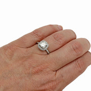 Rare Earth Jewelry Cushion Moissanite Halo Ring on Finger 14K Forever One
