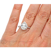 Rare Earth Jewelry Moissanite Engagement Ring on Finger Pear Shaped Forever One Halo