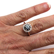 Gray Moissanite Ring Round Cluster Style in Rose Gold on the Finger from Rare Earth Jewelry