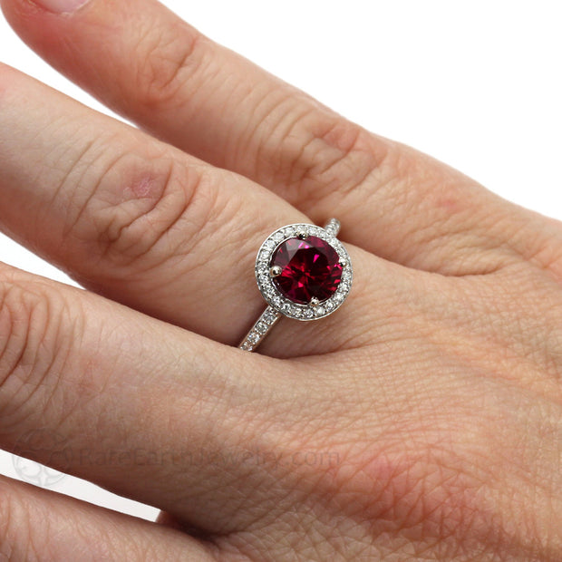 Ruby Diamond Halo Engagement Ring on Finger by Rare Earth Jewelry