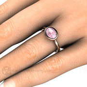 Rare Earth Jewelry Sapphire Engagement Ring on Finger Bezel Oval East West Setting Peach Pink Gemstone