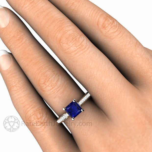 Rare Earth Jewelry Sapphire Engagement Ring on Finger Princess Square Cut Diamond Accented