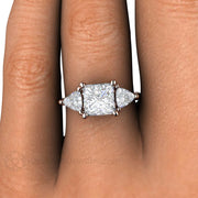 Rare Earth Jewelry Square Princess Moissanite Engagement Ring on Finger 14K Rose Gold 3 Stone