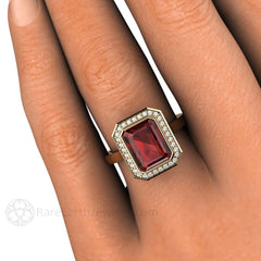 Bezel Set Emerald Cut Halo Garnet Ring on Finger Rare Earth Jewelry