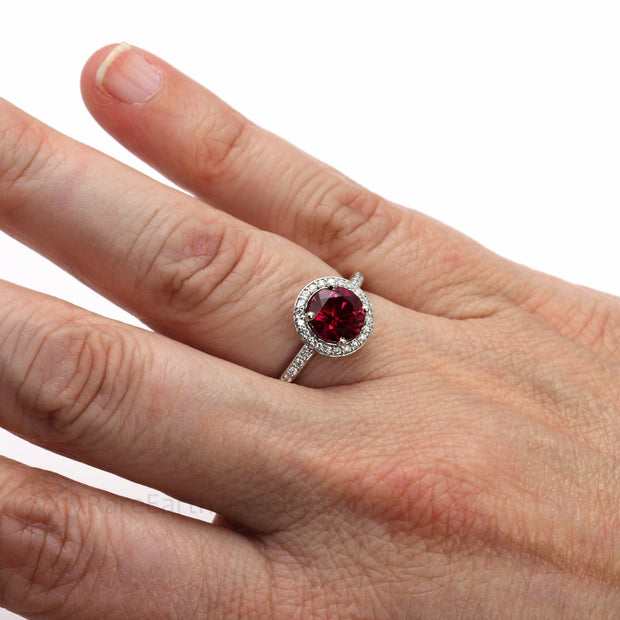 Rare Earth Jewelry Ruby Anniversary Ring on Finger Diamond Halo Platinum Setting