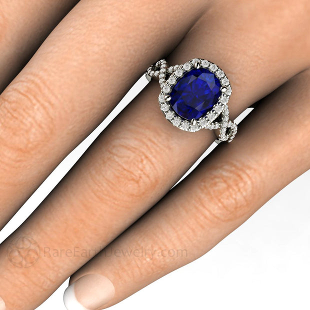 Rare Earth Jewelry 2.75 Carat Cushion Cut Sapphire Engagement Ring on Finger Diamond Halo Split Shank Infinity Setting