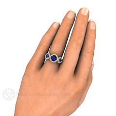 Three Stone Sapphire Engagement Ring on Finger Rare Earth Jewelry