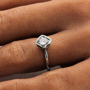 Simple Solitaire Engagement Ring Eco Friendly Diamond Alternative Moissanite on the finger