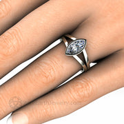 Split Shank Engagement Ring on the finger Marquise Moissanite Bezel Setting