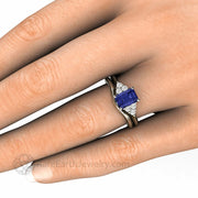 Tanzanite Three Stone Engagement Ring on the Finger
