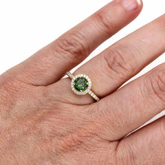 Green Tourmaline Halo Ring on Finger Rare Earth Jewelry