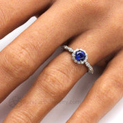 Vintage style Blue Sapphire engagement ring with round lab grown blue sapphire stone and diamond halo on a scalloped design band