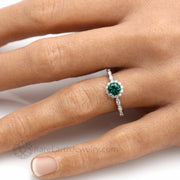 May Birthstone Engagement Ring Green Emerald and Diamond Ring on the Hand Made in America by Rare Earth Jewelry