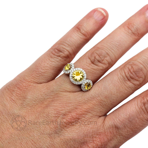 Yellow Sapphire 3 Stone Halo Ring on Finger - Rare Earth Jewelry
