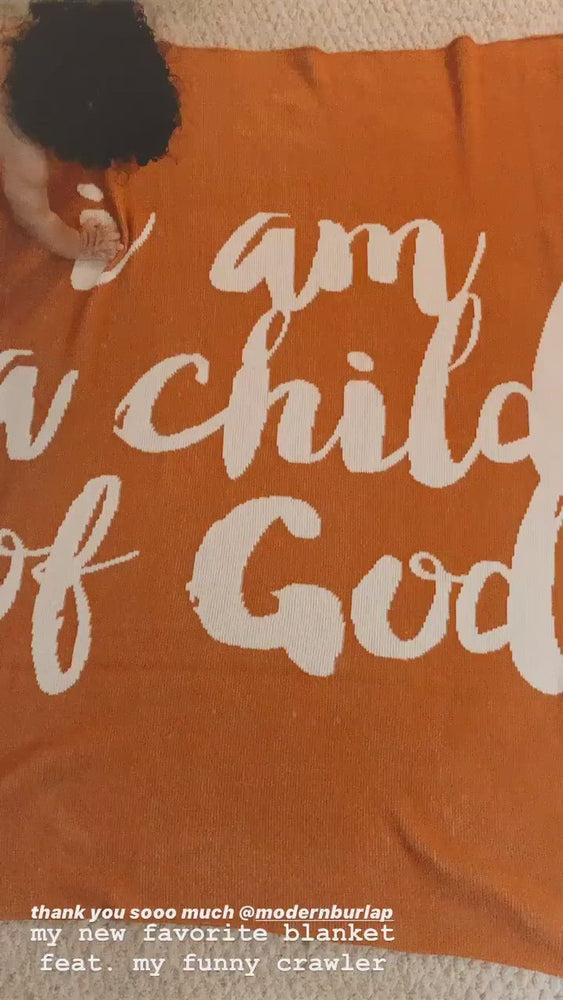 Load and play video in Gallery viewer, *NEW* Made in the USA | Recycled Cotton Blend  I am a child of God Throw Blanket | Braza Orange