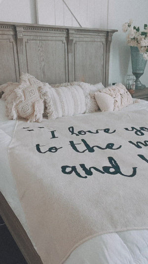 Load and play video in Gallery viewer, Made in the USA | Recycled Cotton Blend I love you to the moon and back Throw Blanket | Natural