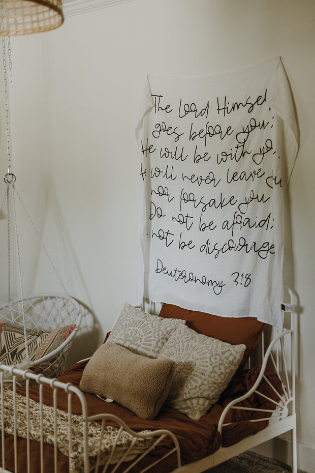 Organic Cotton Muslin Swaddle Blanket + Wall Art - Deuteronomy 31:8 The Lord Himself goes before you; He will be with you. He will never leave you nor forsake you. Do not be afraid; do not be discouraged. 1