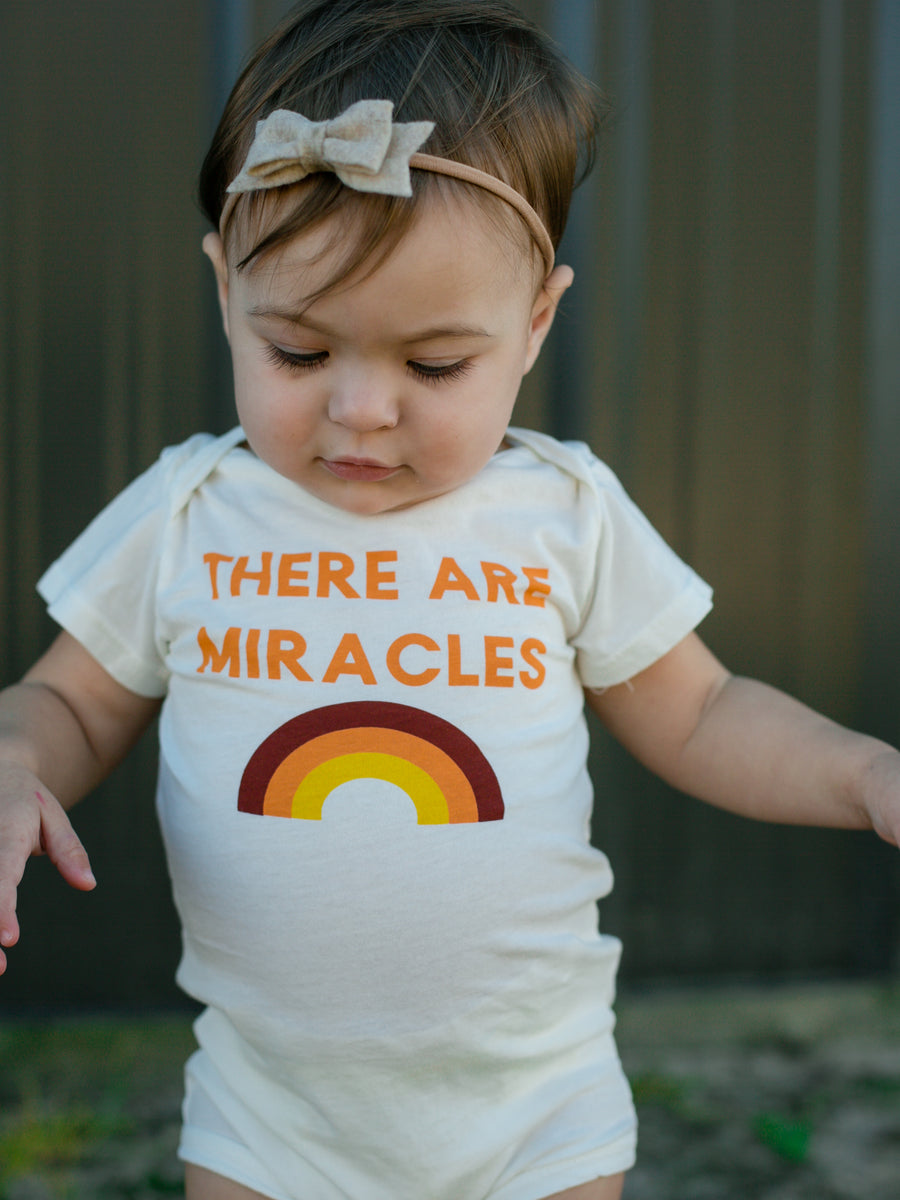 There are miracles Onesie