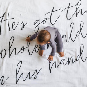 Organic Cotton Muslin Swaddle Blanket + Wall Art -   He's got the whole world in his hands