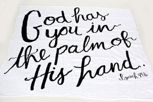 Load image into Gallery viewer, Organic Cotton Muslin Swaddle Blanket + Wall Art -  GOD HAS YOU IN THE PALM OF HIS HAND. ISAIAH 49:16
