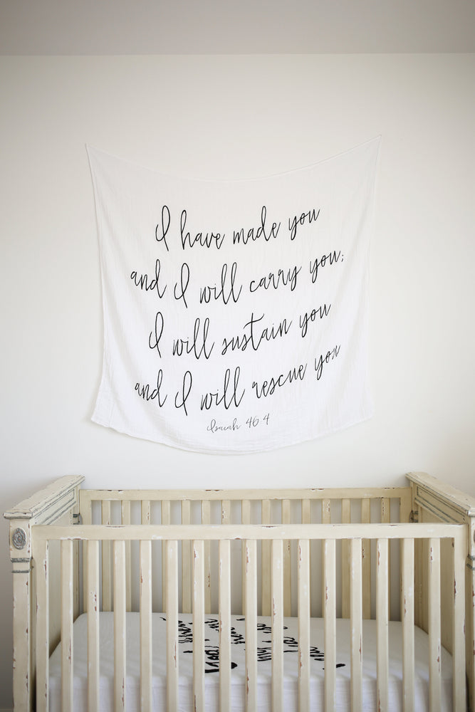 Load image into Gallery viewer, Organic Cotton Muslin Swaddle Blanket + Wall Art -   I have made you and I will carry you; I will sustain you and I will rescue you. Isaiah 46:4