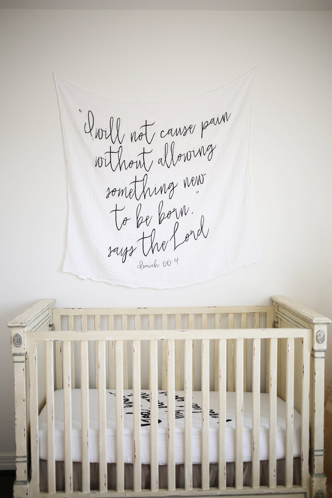 "Load image into Gallery viewer, Organic Cotton Muslin Swaddle Blanket + Wall Art - ""I will not cause pain without allowing something new to be born,"" says the Lord. Isaiah 66:9"