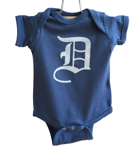 Old English D, white print on indigo blue, Detroit Baby Onesie. Well Done Goods by Cyberoptix