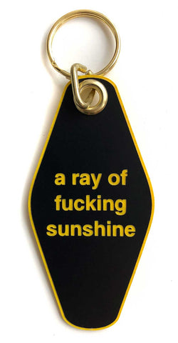 a ray of f*cking sunshine keychain at well done goods