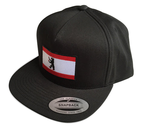 Berlin Flag Snapback Cap, black. Well Done Goods