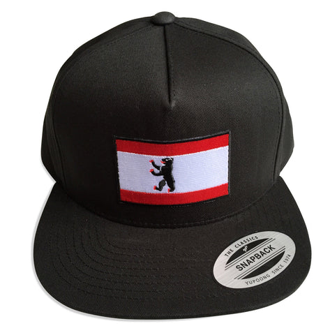 Berlin City Flag Snapback Cap, black. Well Done Goods