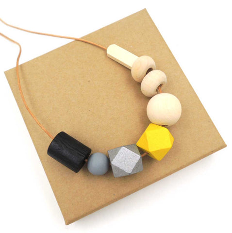 Wood Bead Necklace: black, grey, yellow, natural. Well Done Goods