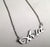 Acid script nameplate necklace, silver. By well done goods