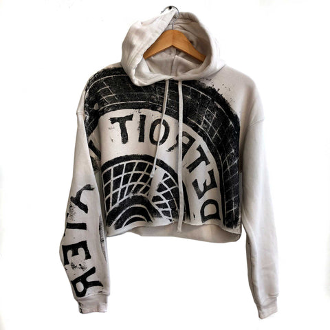 Manhole Cover Women's Cropped Pullover Hoodie, Detroit Tire Print. Black on Heather Dust