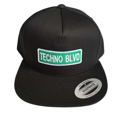 Techno Blvd Snapback Cap, Green Street Sign Patch. Well Done Goods