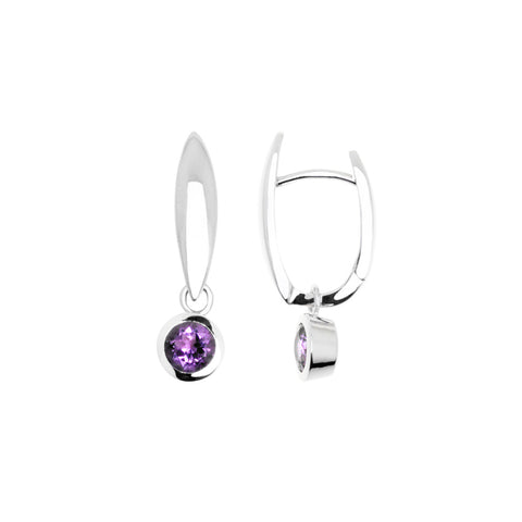 Adalia earring amethyst is a sterling silver huggie earring featuring a blue topaz stone in a bezel setting.