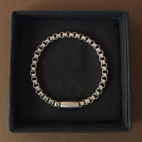 Mens stainless steel bracelet 21cm long with interlocking, curved square links 5mm wide in contemporary design with a magnetic feature clasp.