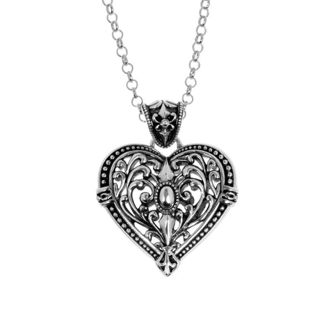 Giselle pendant is heart-shaped, ornate, floral design in sterling silver featuring a similarly ornate bale.