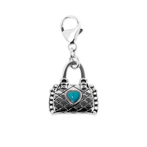 Sterling silver 3 dimensional handbag charm with decorative criss-cross pattern and a synthetic turquoise heart stone in the centre.  Attach to a bracelet, chain, zipper or keyring, ref 7245.
