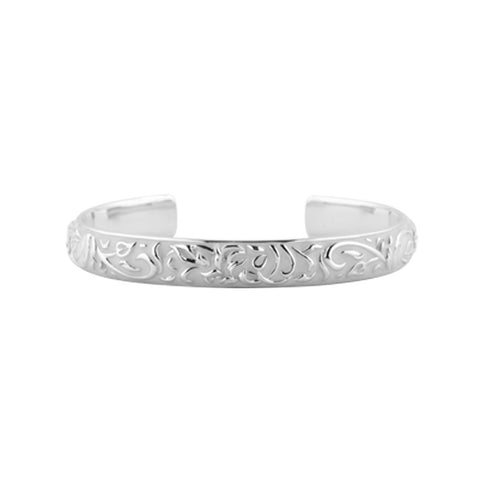 Sterling silver and ivory coloured enamel cuff bangle with a raised floral motif, 6mm wide, 65mm inner diameter.